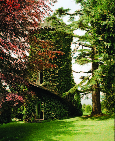 Marella Agnelli's gardens at Villar Perosa.  The 19th century water cistern, designed to mimic a medieval tower, is on the lawn in front of the villa and has served as a playground for generations of Agnelli children.  Photo by Francois Halard.
