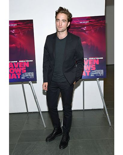 GQ.com: Robert Pattinson in New YorkPattinson's got just the right amount of sheen going on here. Any shinier and it'd be off the mark. We like the way he keeps the casual vibe rolling with the T-shirt and the combat boots.  Photo: Gary Gershoff/WireImage.