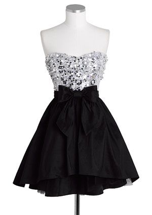 "Strapless Exposed Tulle Dress  Item#: 304928  Price: 79.50  Color: black multi  Add to Wish List 	Email a Friend 	Share This Product  Strapless allover sequin and mesh top dress with front bow detail. Exposed tulle at bottom with zipper for better fit.        Poly      35"" long      Imported"
