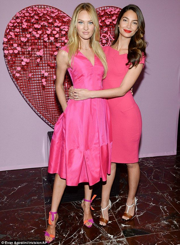 0ae874e2a8d Candice Swanepoel and Lily Aldridge display figures in pink dresses ...