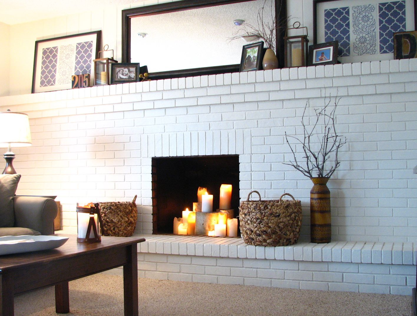 Living room large white brick fireplace wall paired with charming