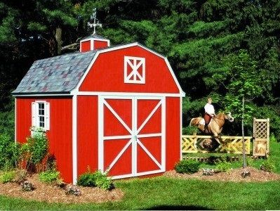 Gambrel Barn Shed with a farmhouse look. The traditional red farm colors trimmed in white makes me feel like a kid again!  That's me on the horse:)...lol - just kidding!  Accented with a side window, loft and gray composite shingles adds a bit of elegance and charm to any landscape.  Finish off with a cupola and your looking good!