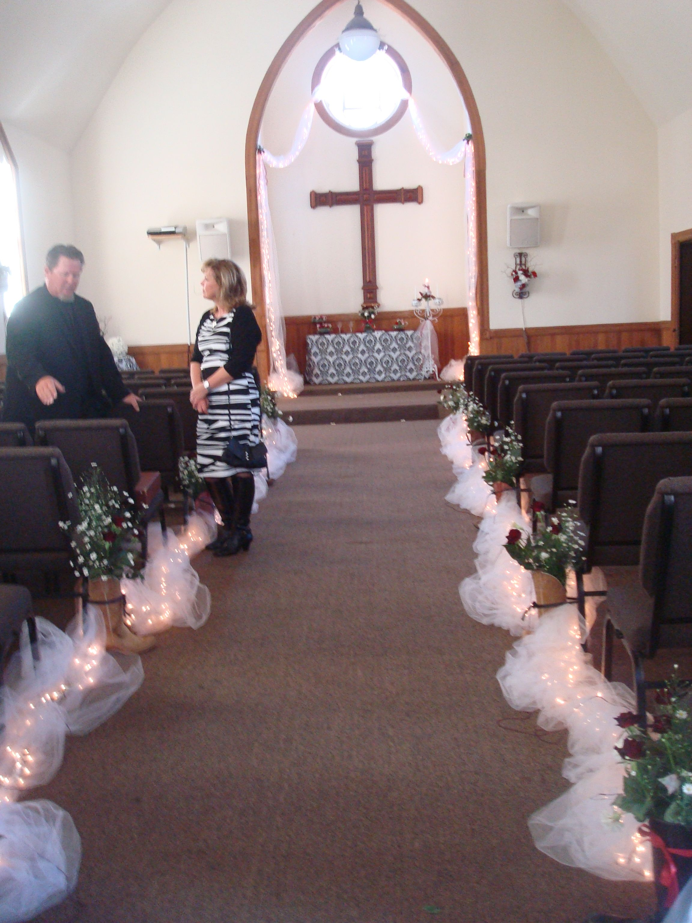 Wedding decorations tulle and lights  Boots with flowers and tulle lighting down the aisle was a kick at