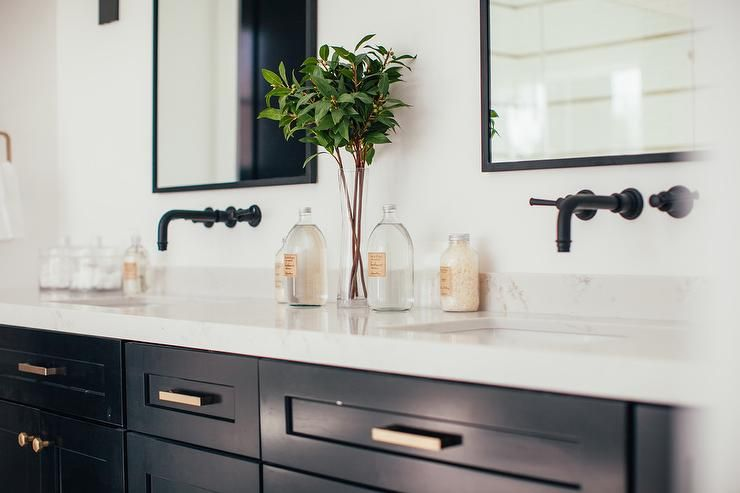 Black Framed Mirrors Hang Over Oil Rubbed Bronze Faucets Mounted