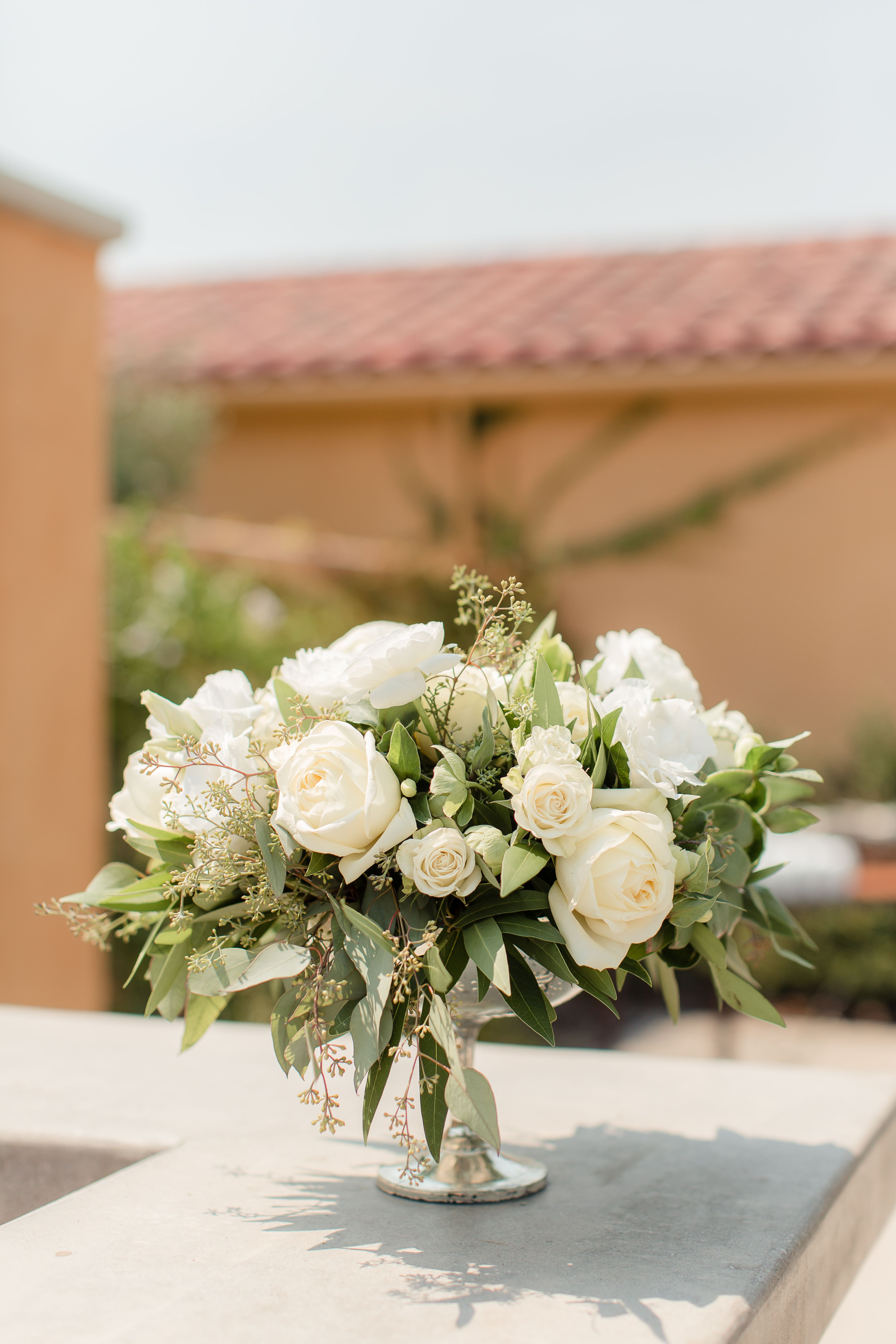 White floral tuscany wedding centerpiece by floral crush wedding