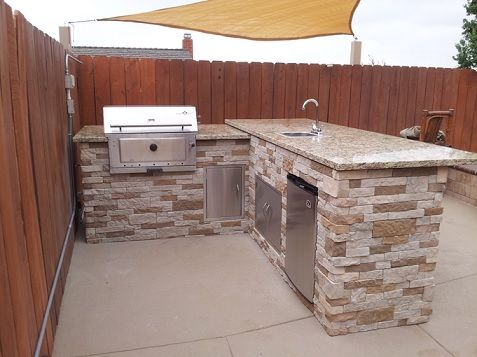 Airstone In Autumn Mountain Ties In Perfectly With Wood Fence Panels Outdoordesign Di Outdoor Kitchen Outdoor Kitchen Design Outdoor Kitchen Design Layout
