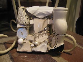 Double switch plate in white with chunky doll leg, mosaic art.