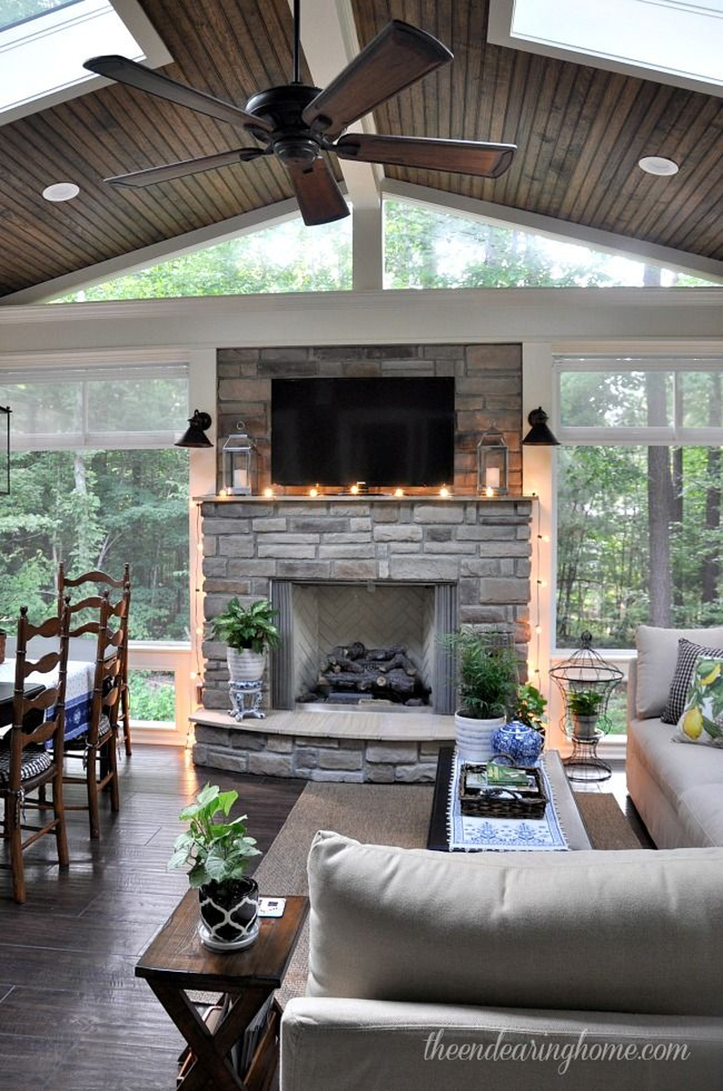 3 season porch window ideas   the floor to ceiling windows flanking the fireplace  dream
