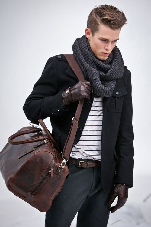 Men's Black Military Jacket, White and Black Horizontal Striped Crew-neck  T-shirt, Charcoal Chinos, Dark Brown Leather Holdall