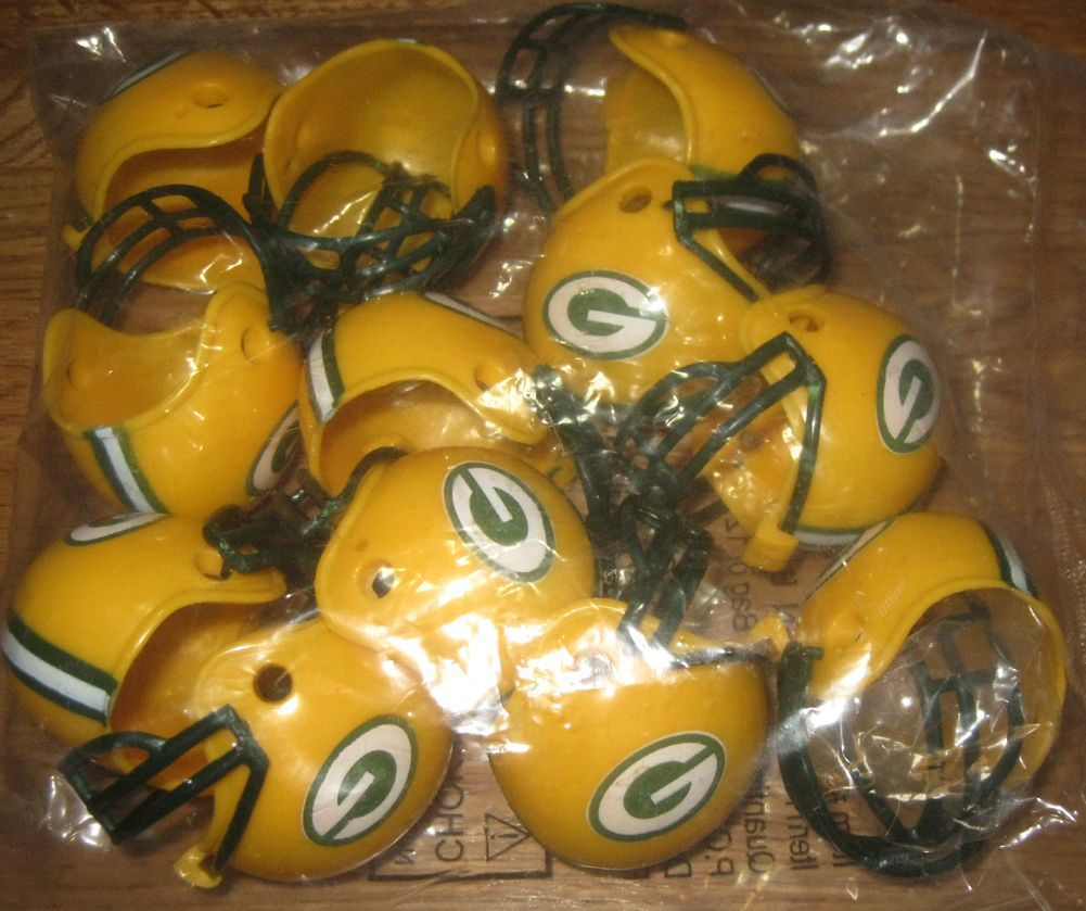 12 miniature GREEN BAY PACKERS HELMETS NEW 1 1/2 X 2 inches new