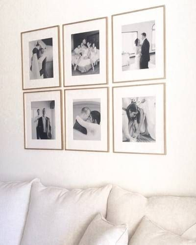 We Finally Got Our Wedding Photos Up In These Frames Guys I May Or May Not Be Slightly Wedding Photo Walls Wedding Photo Wall Display Wedding Picture Walls