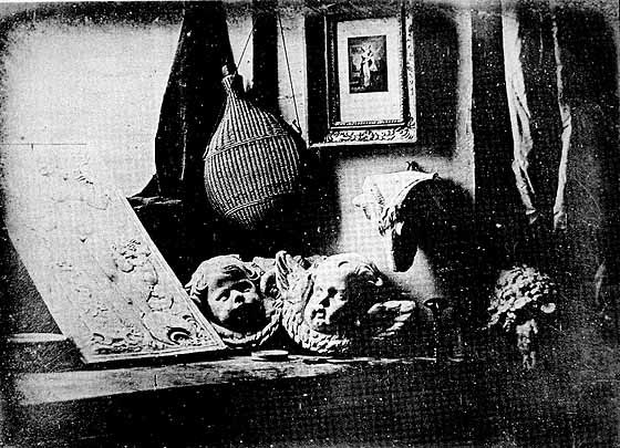 Smarthistory article on early photography, including Louis Daguerre, The Artist's Studio, 1837, daguerreotype
