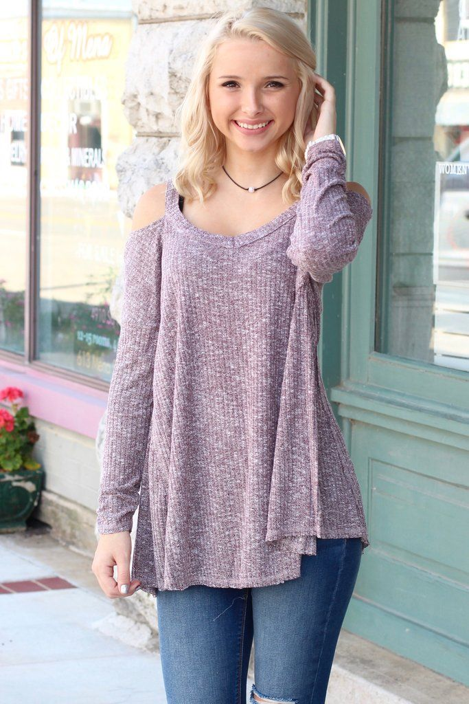 Long sleeved ribbed style sweater with cold shoulders. Right on ...