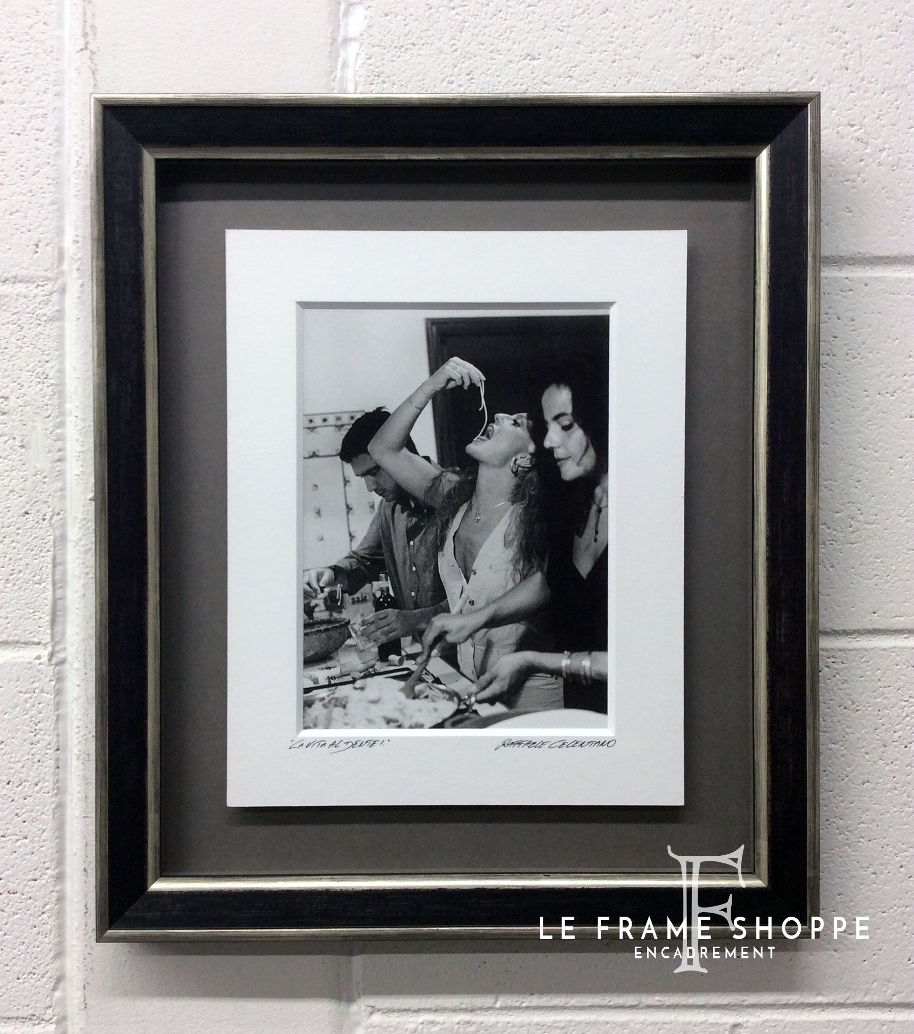 We'll have what she's having! This great photo our client brought back from Italy has a signed and titled mat that is just a little too small to give it an appropriate presentation on the wall. So we float mounted it on a charcoal grey mat and recessed it in (what else) a contemporary #Roma frame. #customframing #Italy #photo #leframeshoppe #lifeisbetterframed