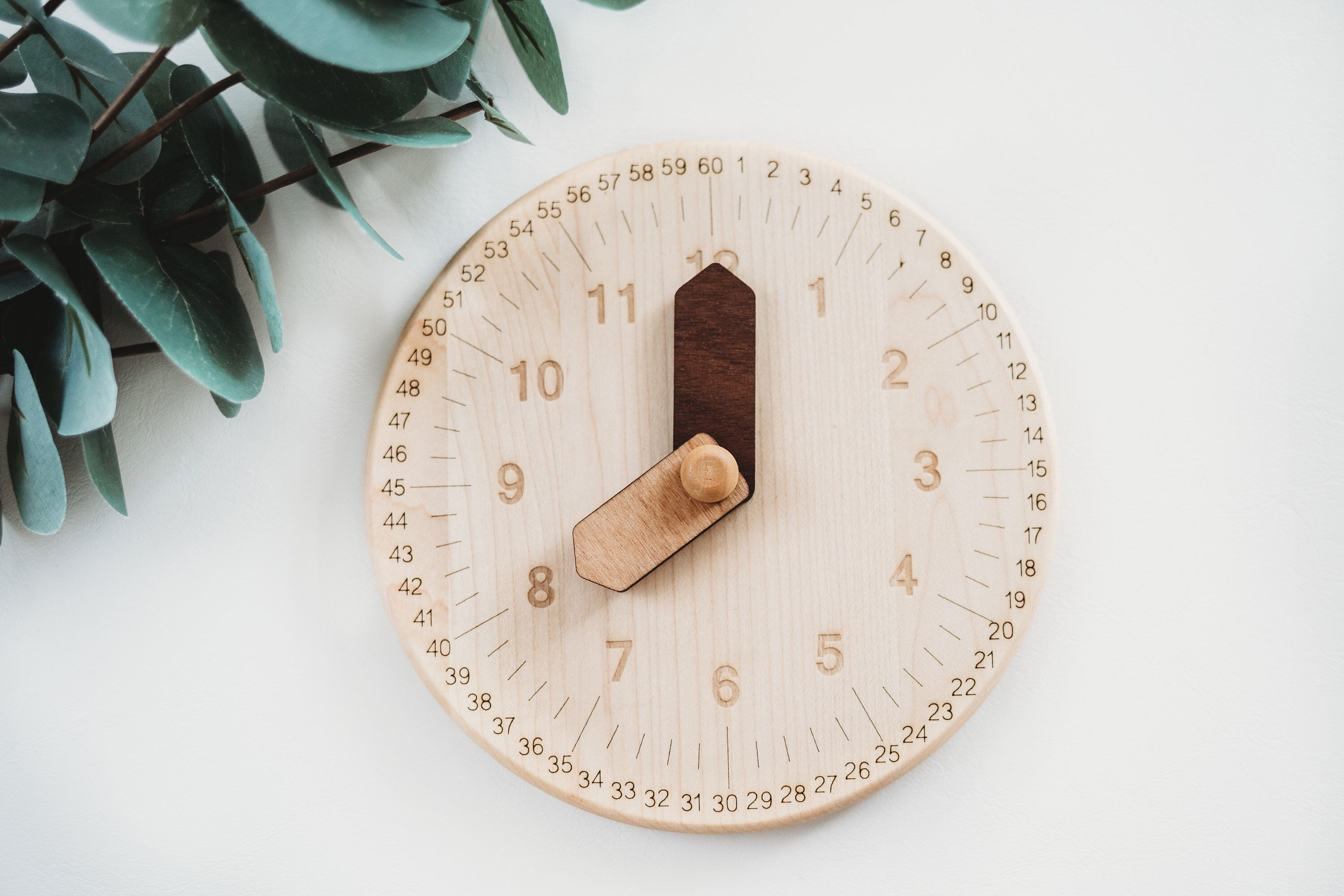 Wooden toy clock with minute and hour in different shades ...