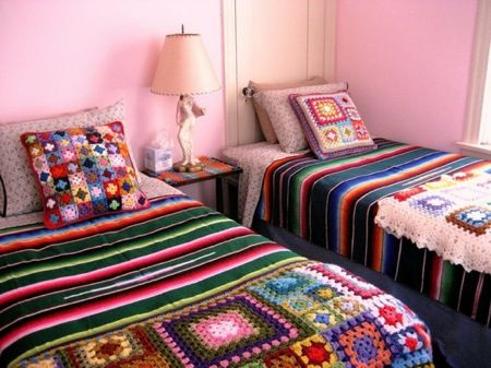 Love the blankets and pillows on the beds!
