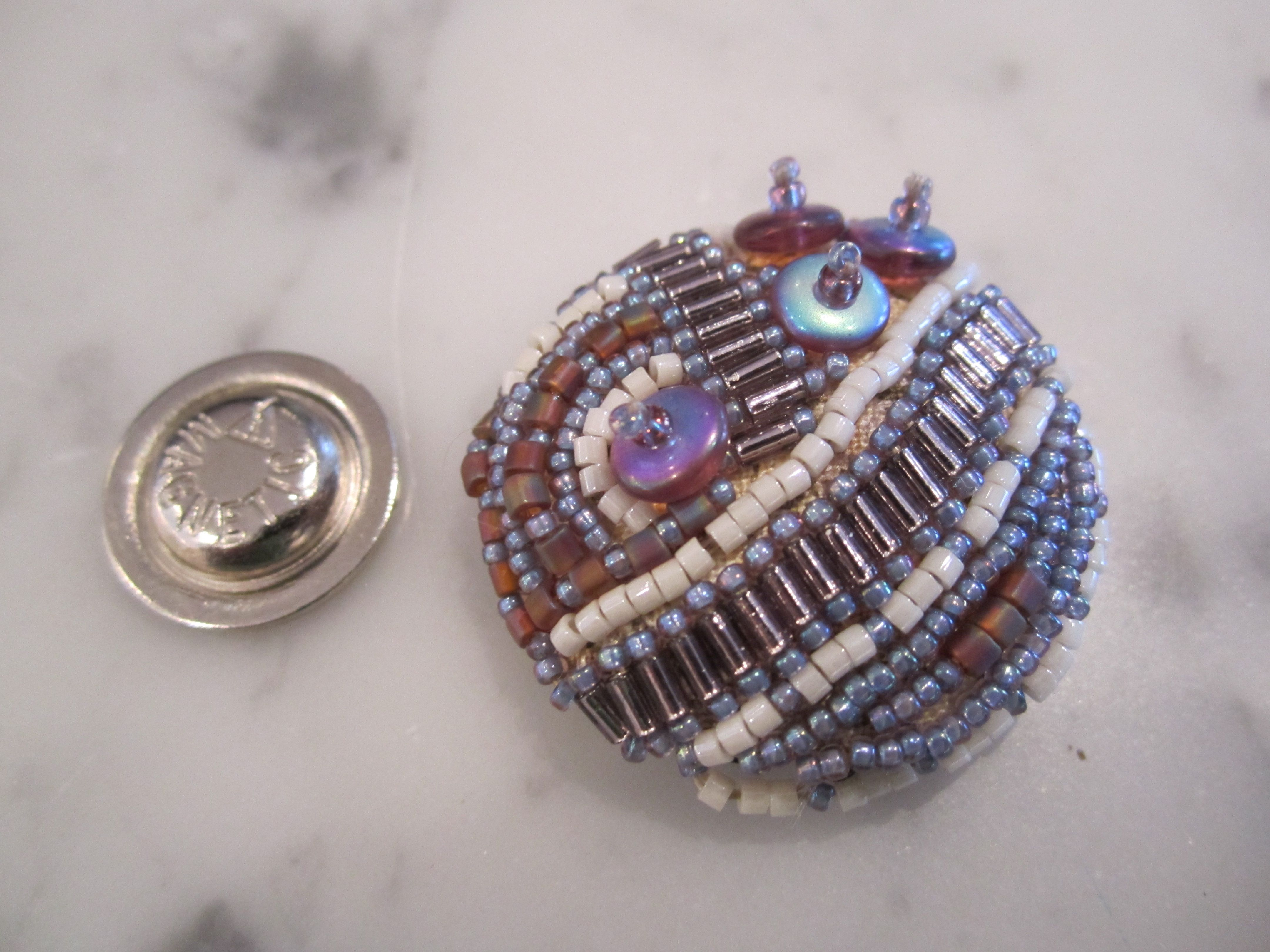 Beaded button - replaced shank with magnet so it won't make holes in clothes