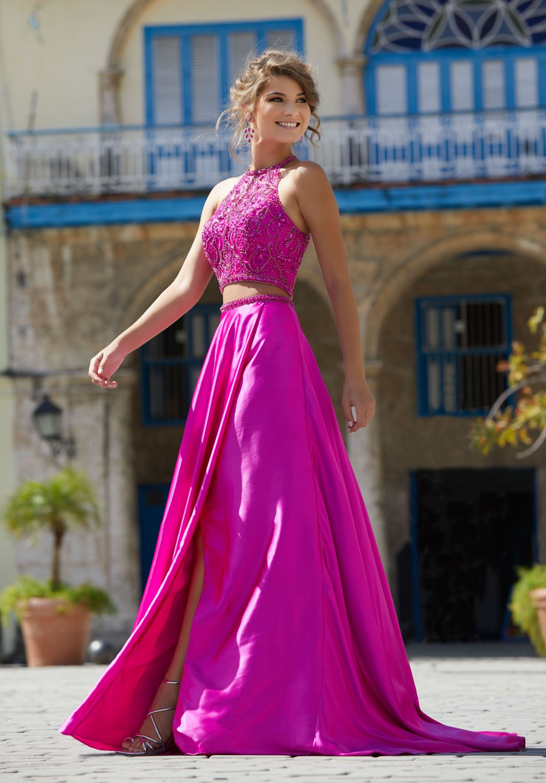 Sleek charmeuse twopiece prom dress featuring a fully beaded high