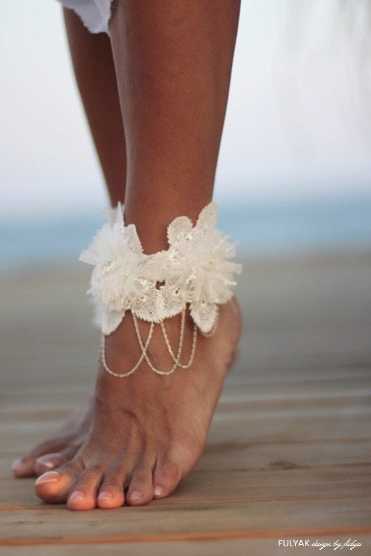 Flowers tangled on chain barefoot sandal beach wedding