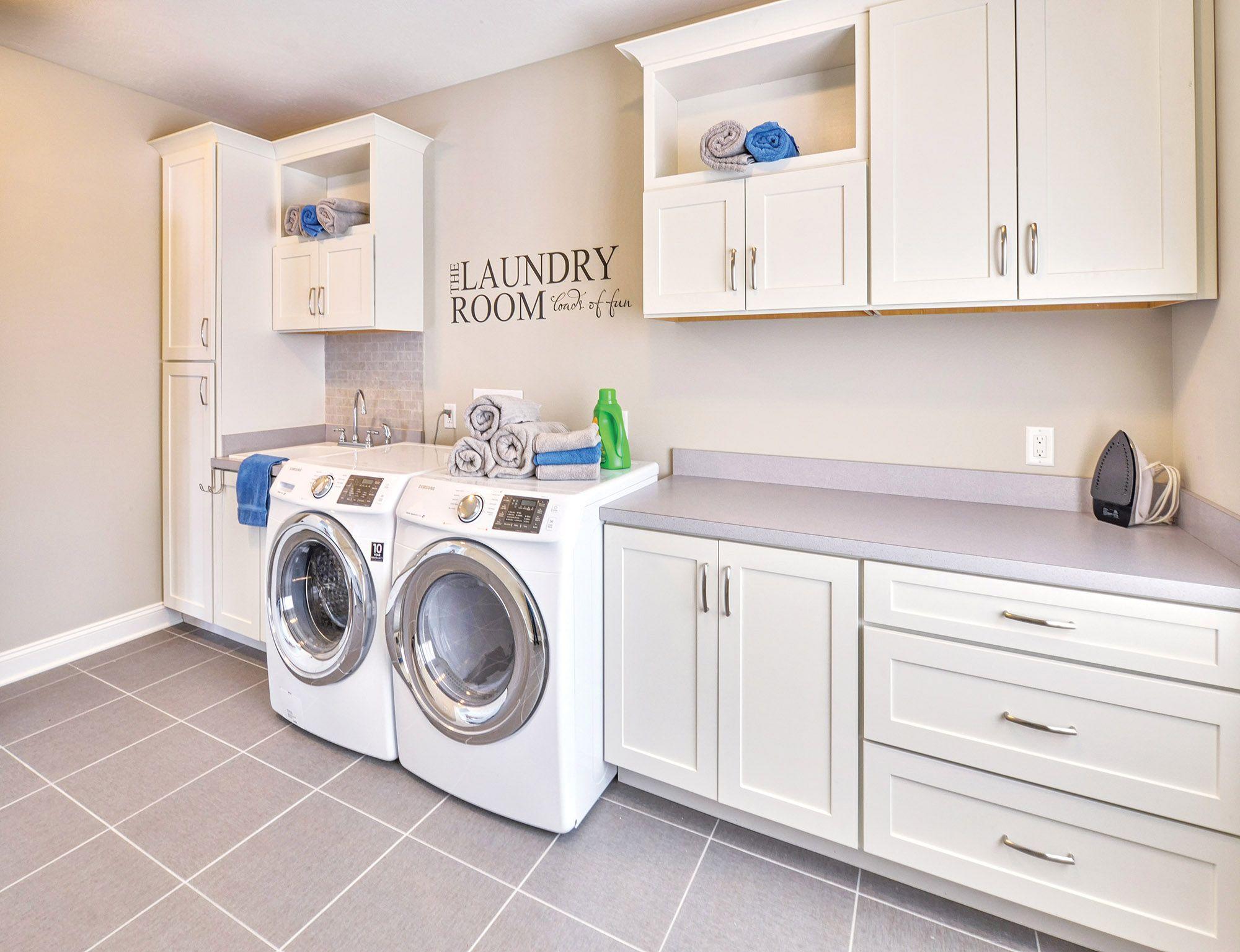 Spacious and bright laundry room custom built with CliqStudios.com ...