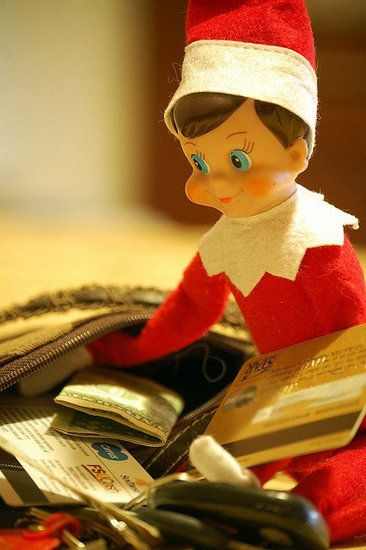In Mom's Purse: what a clever setup. Surely the elf is reminding mom it's time to do some Christmas shopping?