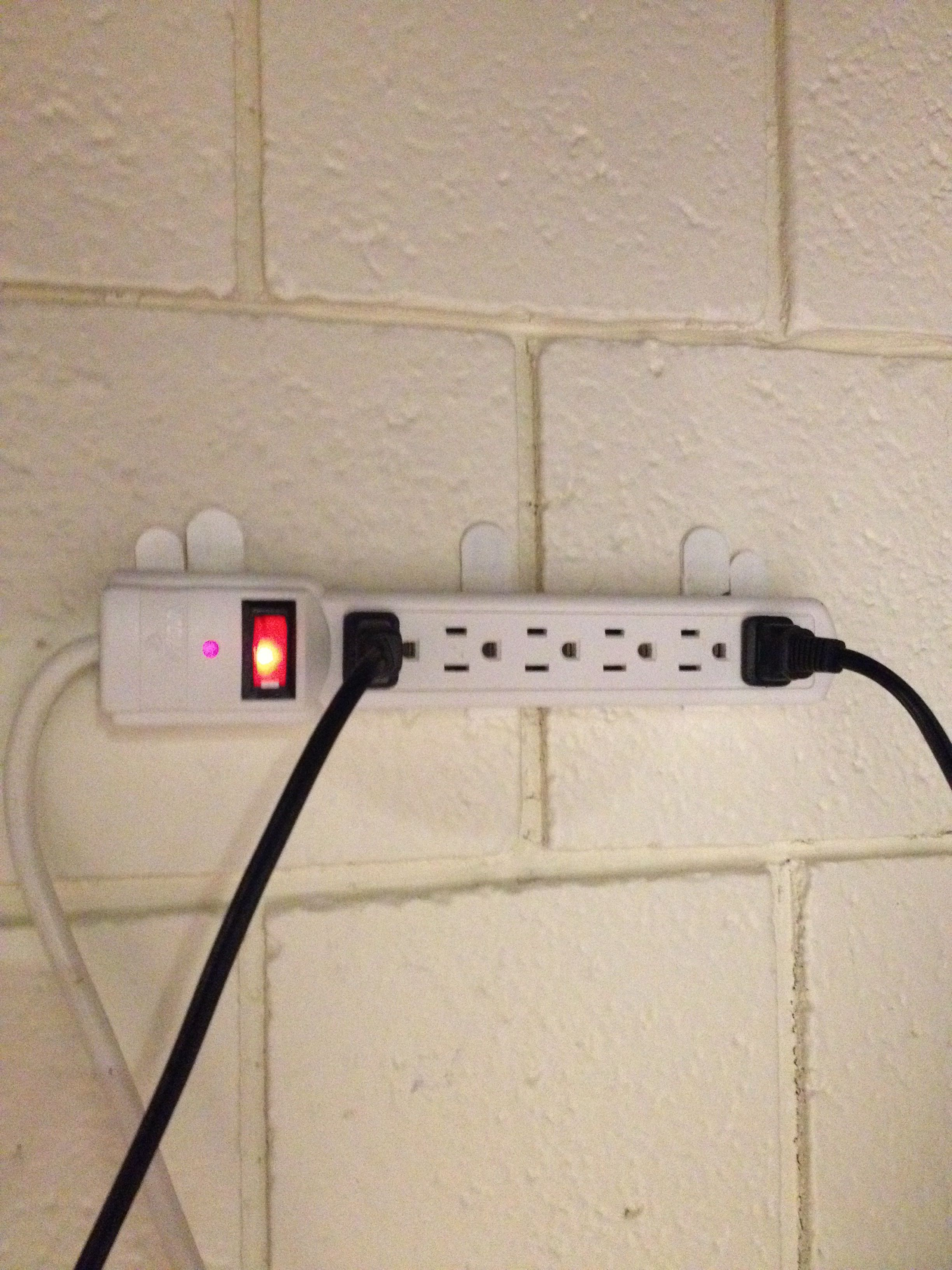 Command strips to mount power strips extremely useful in