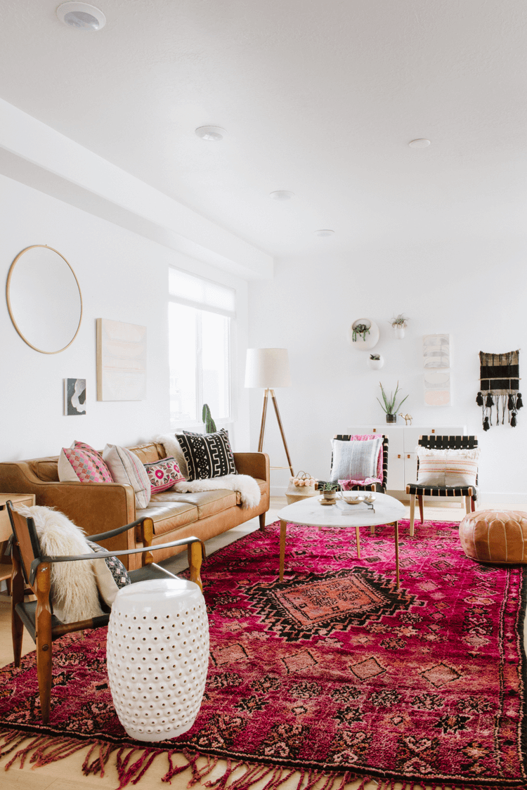 A Vintage Living Room With Pink Rug And Tan Leather Pouf Rugs In Living Room Pink Living Room Moroccan Living Room