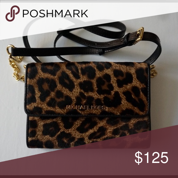 5100ebbe28b9 Leopard-print calf hair crossbody Michael Kors crossbody bag with soft  exterior. 7