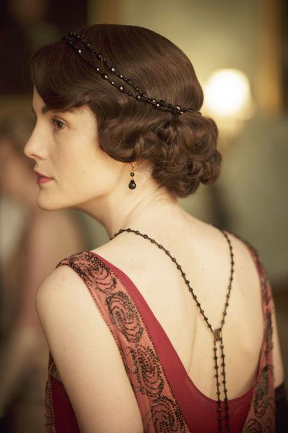 'Downton Abbey' - Lady Mary Crawley played by Michelle Dockery. I love the necklaces that go down the exposed back.