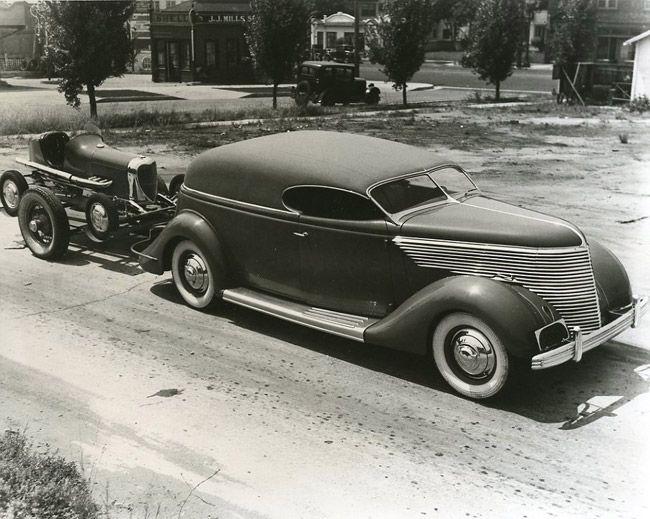 A Frank Kurtis chopped 1936 Ford hauls a Leonard De Bell Offy midget race car.