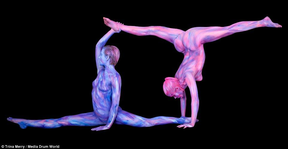 Two particularly flexible models covered in vivid purple and pink body paint got themselves into shape to represent Gemini