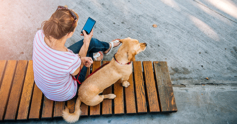 girl on the phone sitting with her dog | Embrace pet ...