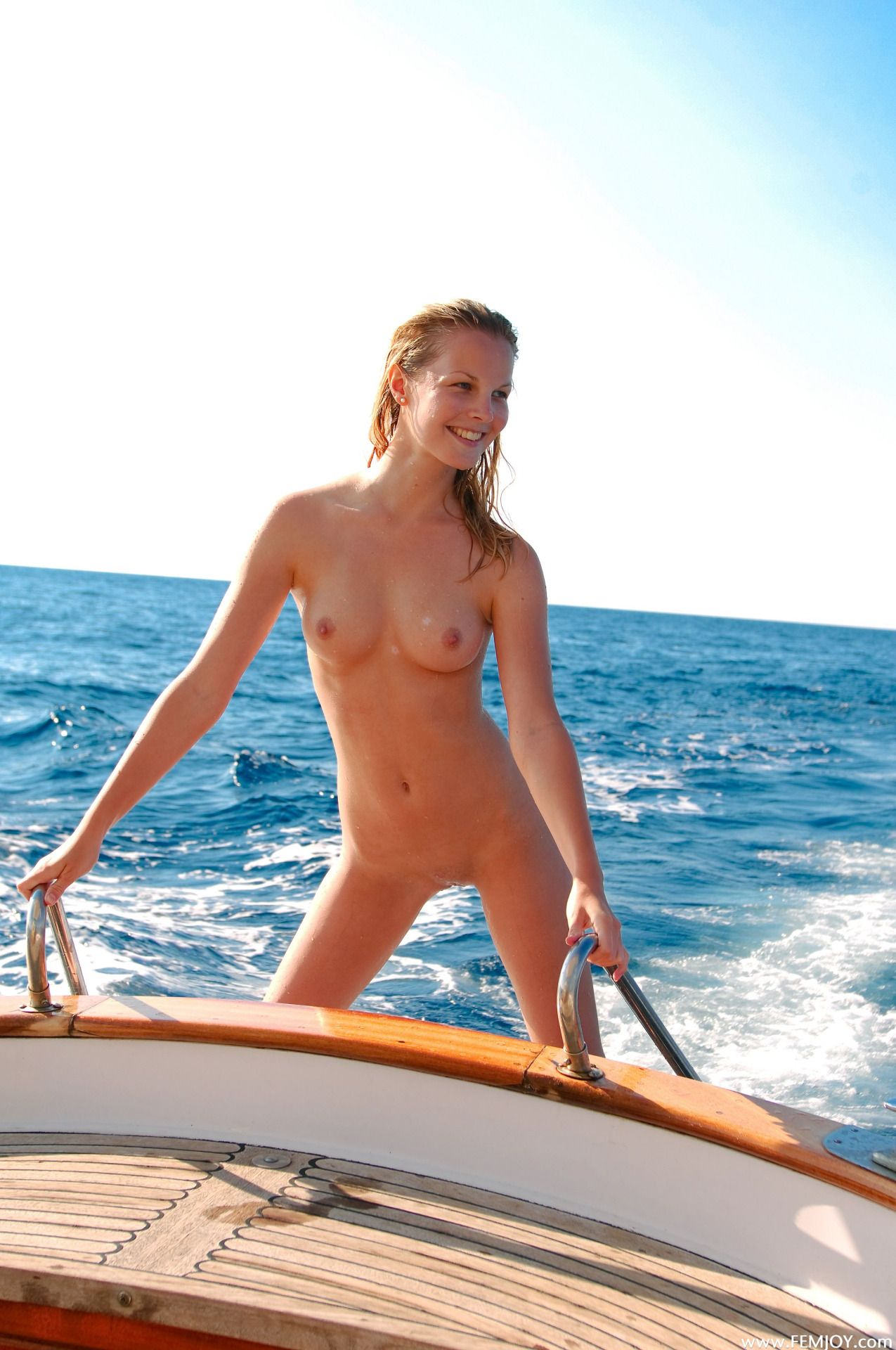women in nudist boat