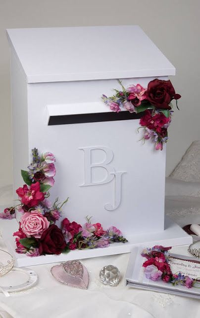 Another nice card box idea--just paint an actual mailbox and glue your initials onto it with some greens and/or flowers.