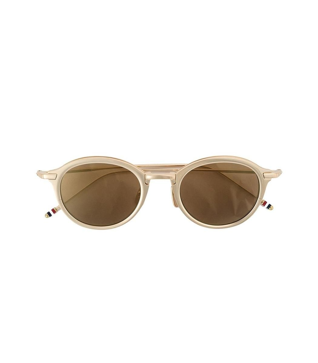 Gold-plated sunglasses featuring a round frame design. ShopBazaar ...