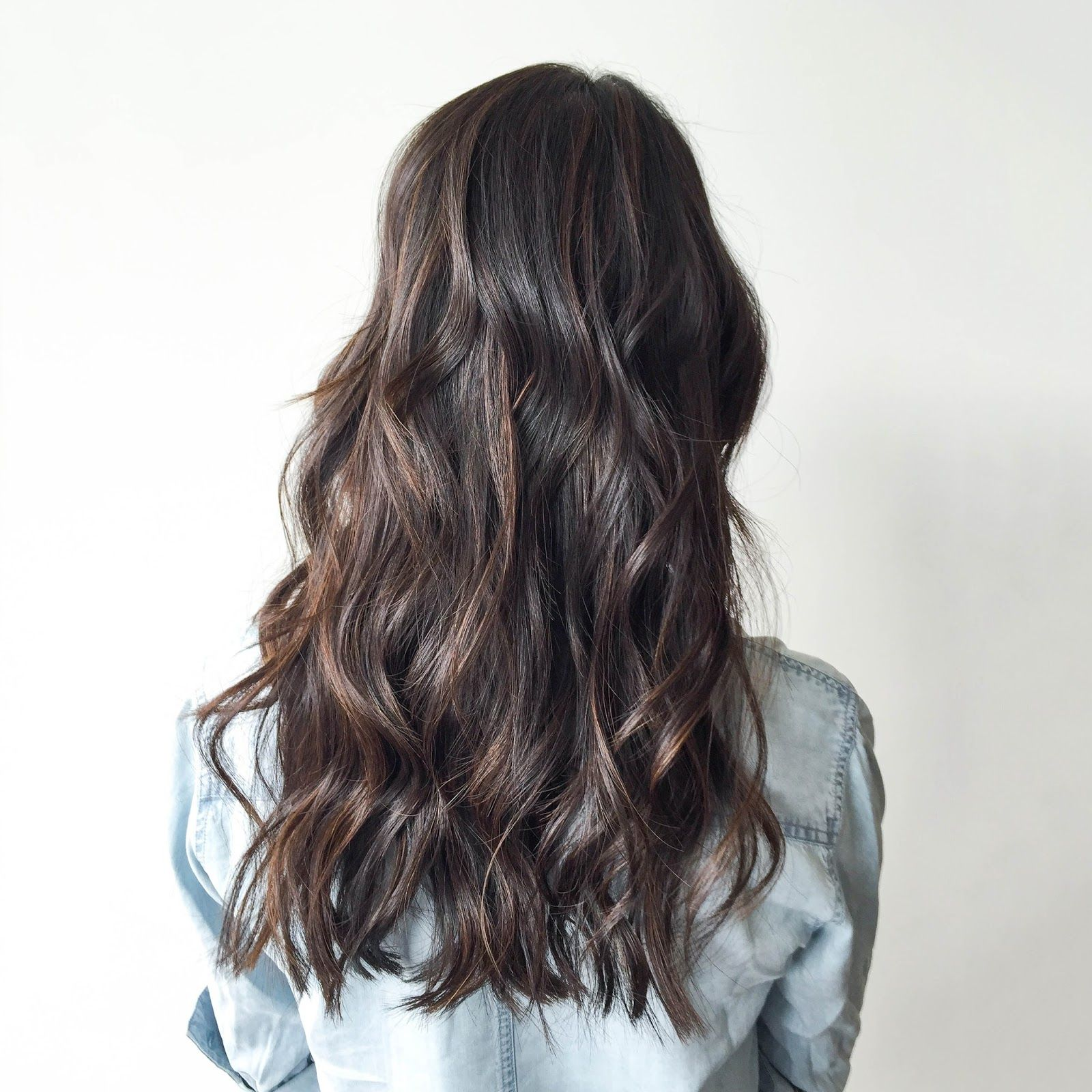 Asian brunette hair layers reverse directional curls balayage