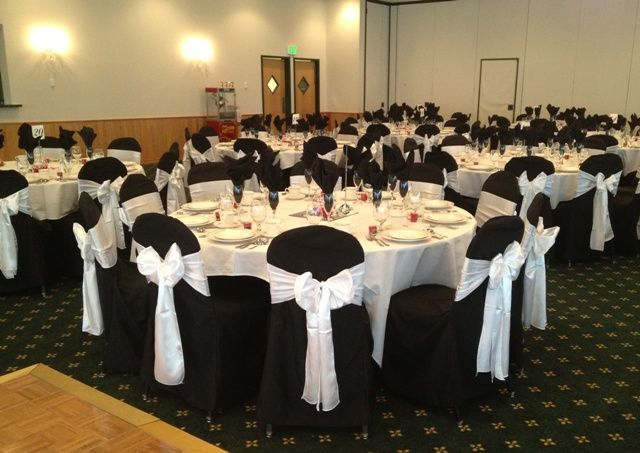 White satin sashes on black chair covers Patrician Schererville