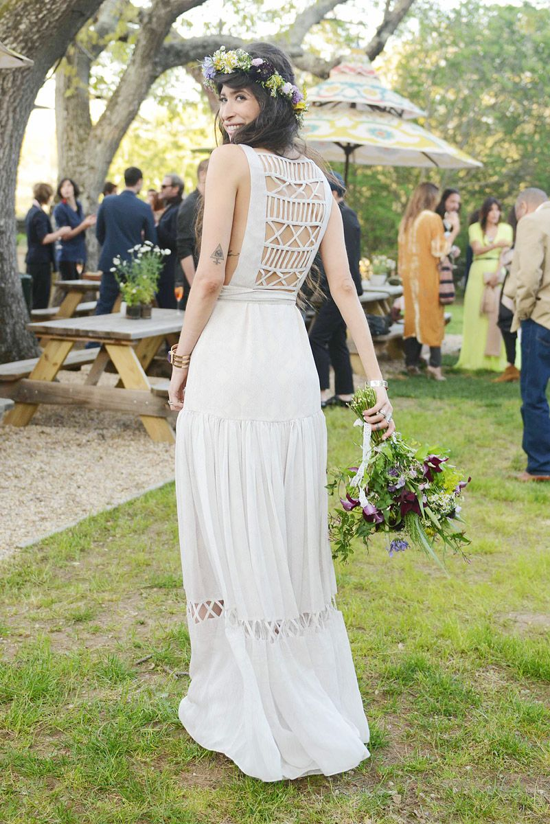 Pamela Love's hippy wedding - back of the dress and the bride's bouquet