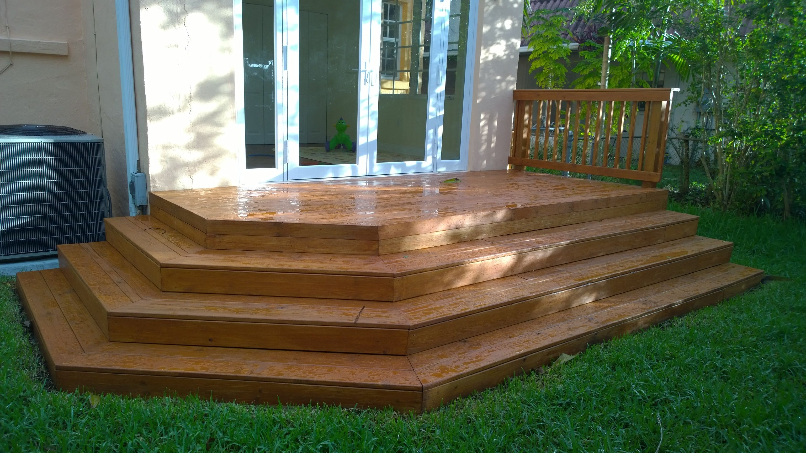 pressure treated wood deck with wrap around stair recent