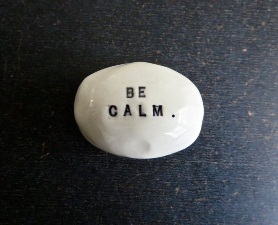 handmade solid ceramic rock with a word imprinted into the clay. can be used as a paper weight, an objet dart, or to leave around for a little inspiration. your rock will come in a muslin bag. aprox. 2 wide x 1 1/4 tall.