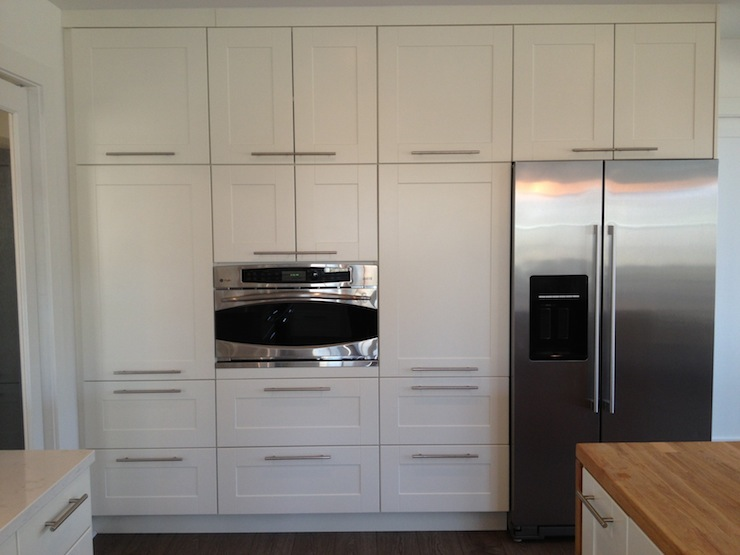 kitchen floor cabinet picture gorgeous with to ceiling cabinets composed of ikea and adel doors in off white features stainless steel refrigerator