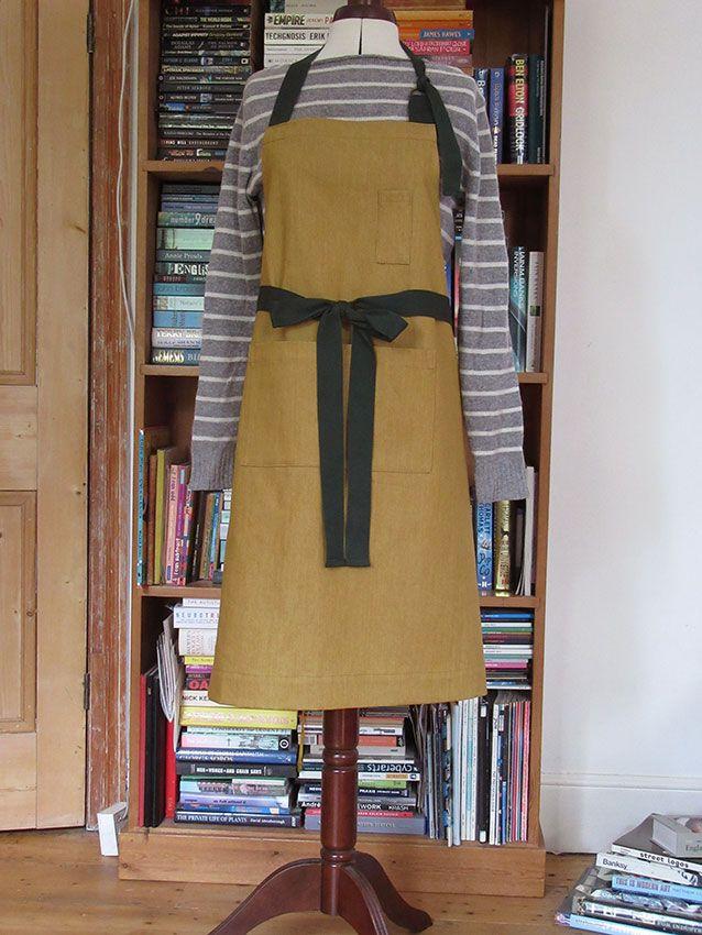 Custom order for Much Ado Books. Ochre denim aprons with dark green ties