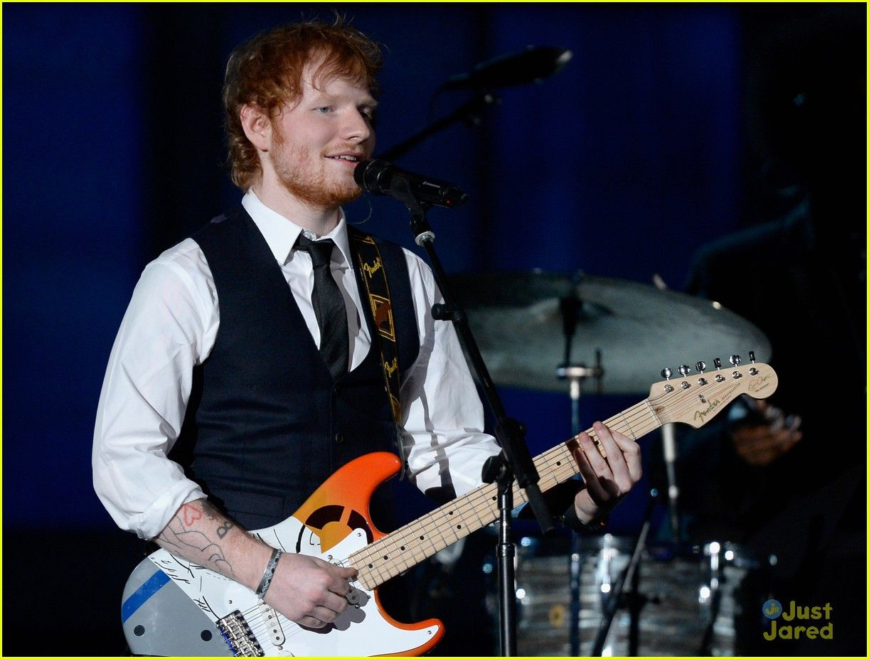 "Ed Sheeran is all smiles while performing his hit song ""Thinking Out Loud"" live on stage at the 2015 Grammy Awards"
