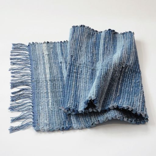 CRAZY AS A LOOM Blue Jean Rug >> KINGBURY, NY >> These are blue-jean woven rugs. Every one is a little bit different, yet very similar. They are all made from real blue jeans, not denim fabric. They are washed, cut into strips, sewn together, and woven on mixed blue cotton warp. $200 at NuBe Green