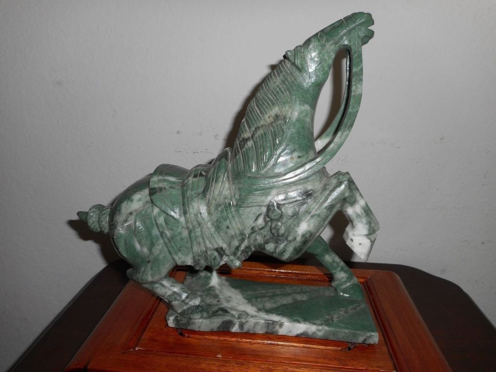 A  CHINESE TANG STYLE  SOAPSTONE CARVING OF A PRANCING HORSE