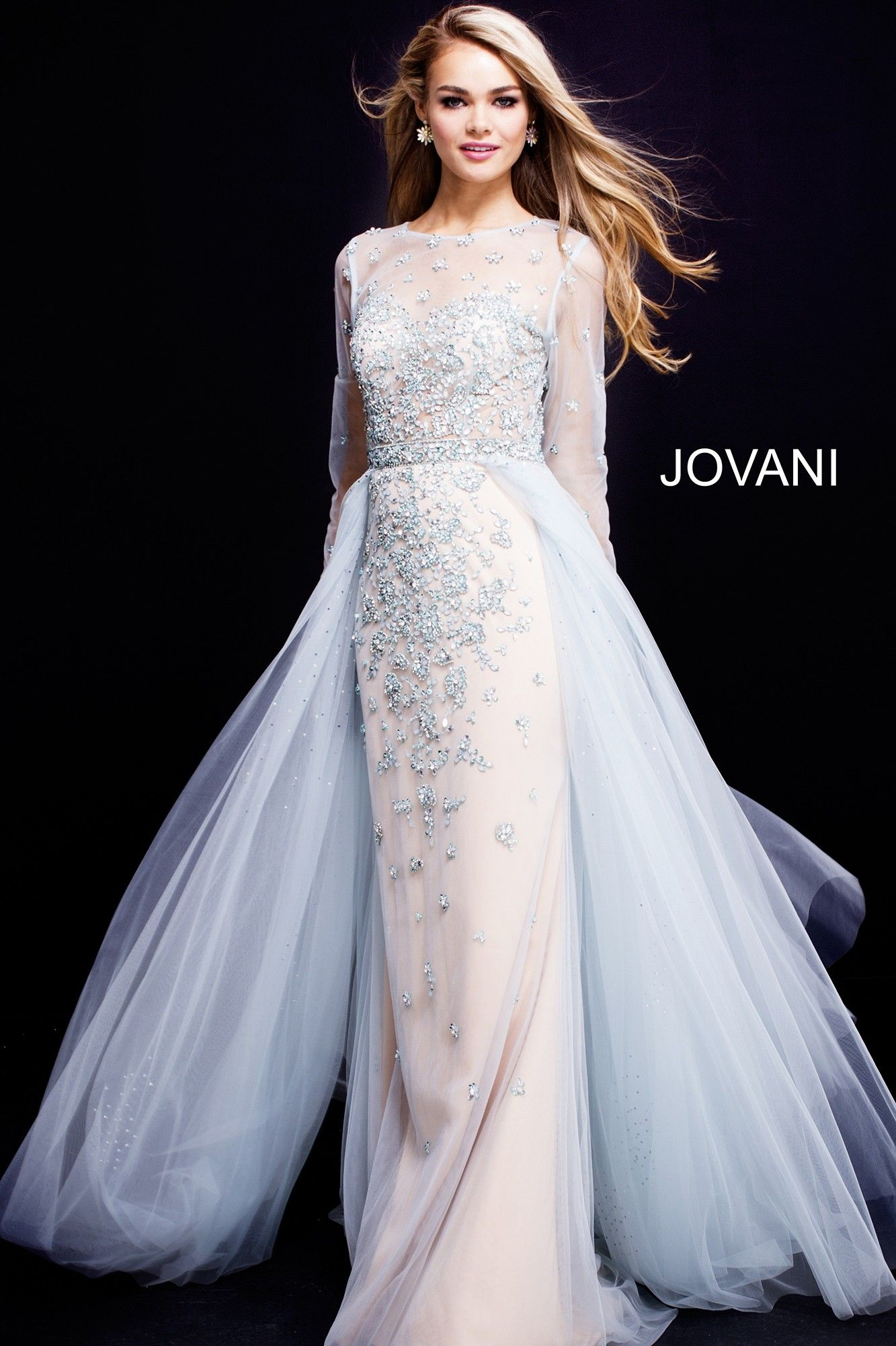 2d23710a256 Dreams come true in Jovani 53743. This magical ball gown delicately  blossoms with jeweled flowers