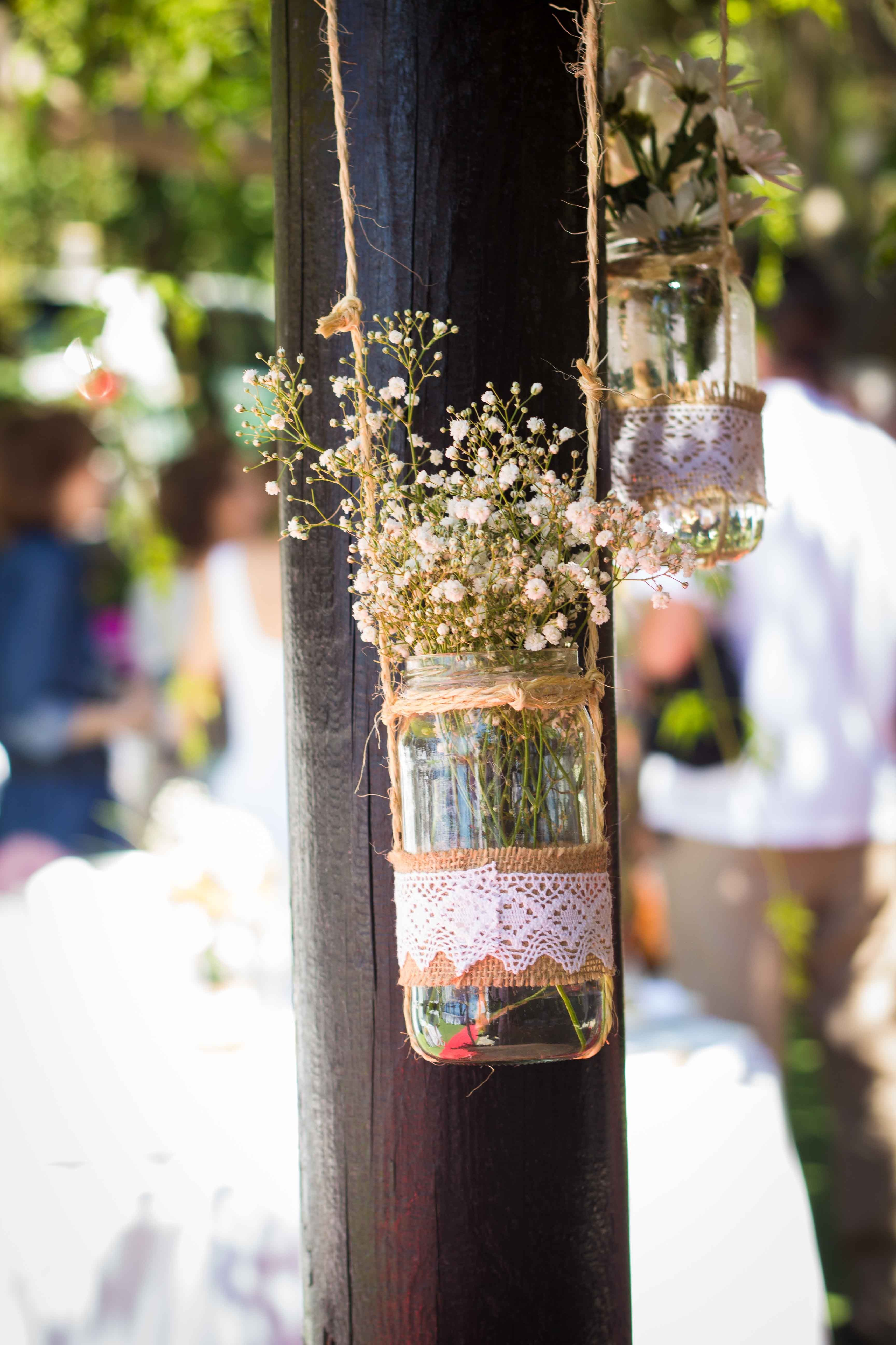 Glass hanging jars with white flowers