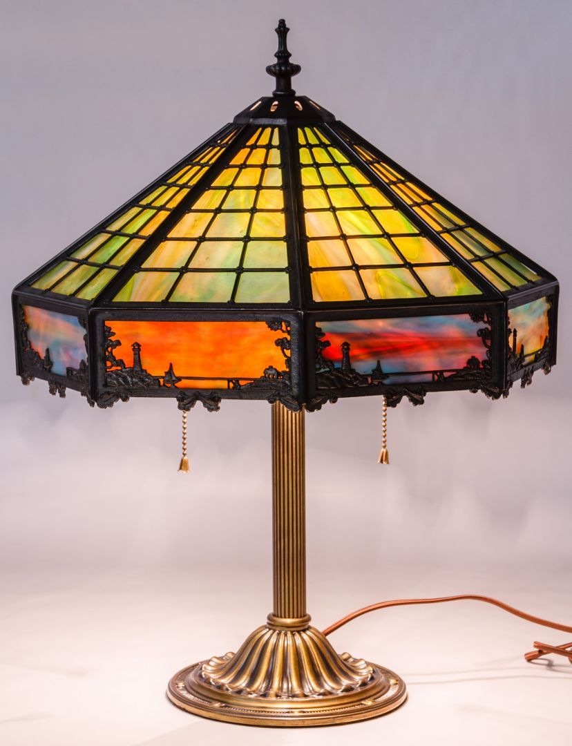 Stamped Maker Mark Towards The Top Of The Lamp Sockets, Slag Glass  Iridescent Shade Depicting A Village Scene