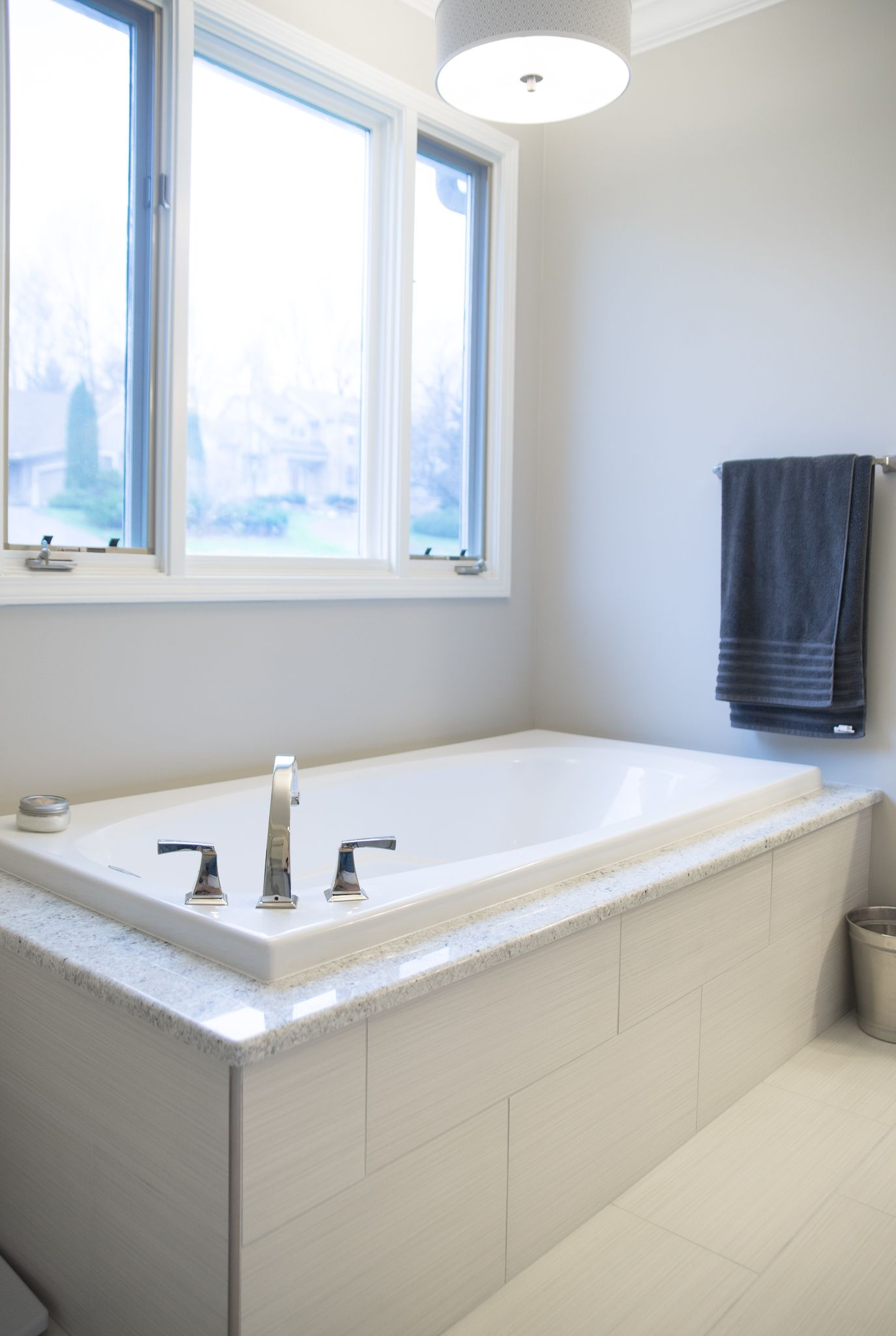 Like to tile on the floor and the river rock in the shower. The ...
