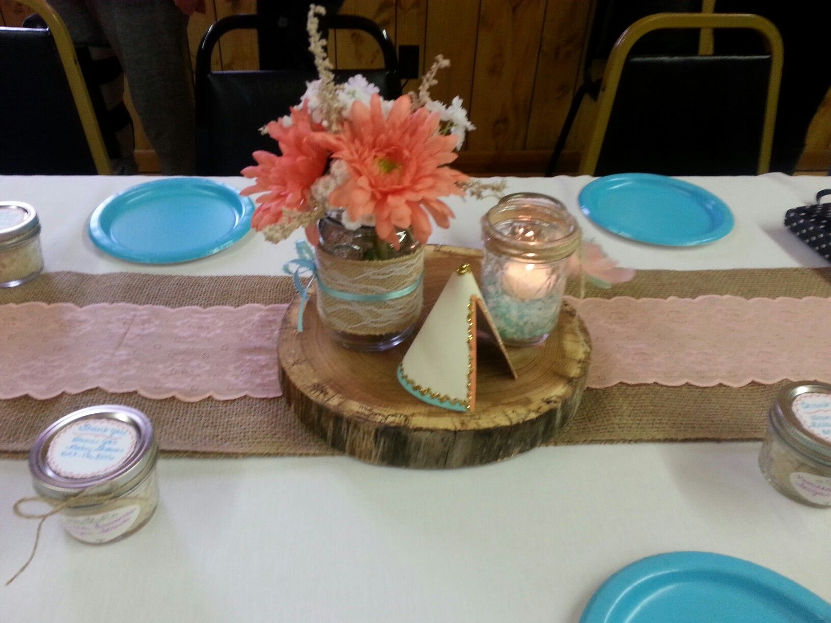 Mason jar centerpieces on wood platters hand painted